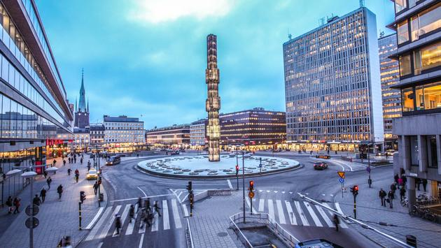 An evening at Sergels Torg with glass Obelisk Kristallvertikalacc in Stockholm, Sweden (photo via bhidethescene / iStock / Getty Images Plus)