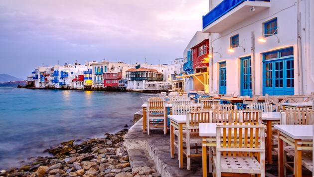 Beautiful sunrise at Little Venice on Mykonos island, Cyclades, Greece (MartinM303 / iStock / Getty Images Plus)