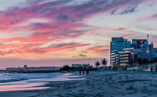 Sunset scene of beach and coastline of Montevideo, Uruguay (Rudimencial / iStock / Getty Images Plus)