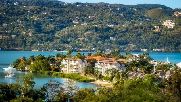 Panoramic image of the seaside view of Doctors Cave Beach, Montego Bay, Jamaica. (lenslooker / iStock / Getty Images Plus)