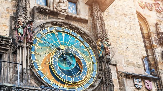 Historical medieval astronomical clock in Old Town Square in Prague, Czech Republic (Photo via Olga_Gavrilova / iStock / Getty Images Plus)