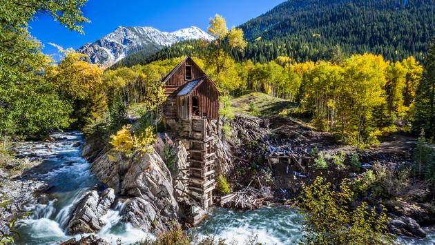 Abandon Crystal Mill in Colorado mountain (photo via kanonsky / iStock / Getty Images Plus)