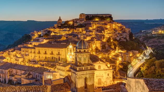 The old town of Ragusa Ibla in Sicily before sunrise (photo via elxeneize / iStock / Getty Images Plus)