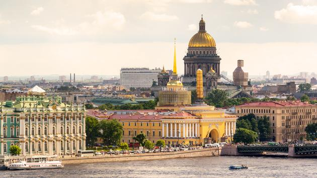 View of the St. Petersburg and the Neva River, Russia. St. Isaac's Cathedral in the distance. (photo via scaliger / iStock / Getty Images Plus)