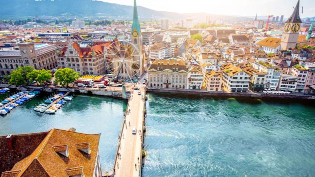 Aerial panoramic cityscape view on the old town of Zurich city in Switzerland (photo via RossHelen / iStock / Getty Images Plus)