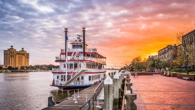 Savannah, Georgia, USA riverfront promenade at sunrise (photo via SeanPavonePhoto/iStock/Getty Images Plus)