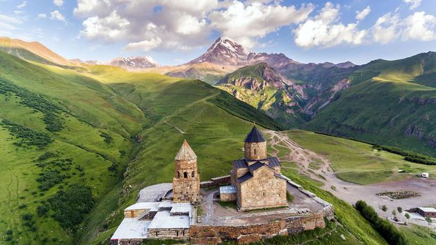 Gergeti Trinity Church Or Tsminda Sameba - Holy Trinity Church Near Village Of Gergeti In Georgia (photo via Dmytro Kosmenko/iStock/Getty Images Plus)