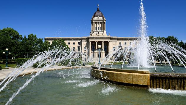 Landscape featuring the Manitoba Legislative Building which is located in Winnipeg, Manitoba. (photo via IanChrisGraham / iStock / Getty Images Plus)