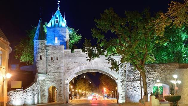 Porte Dauphine gate closeup at night in Quebec City (photo via rabbit75_ist / iStock / Getty Images Plus)