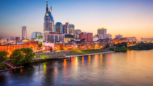 Nashville, Tennessee, USA downtown skyline on the Cumberland River. (photo via SeanPavonePhoto / iStock / Getty Images Plus)