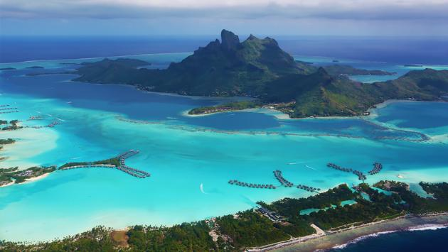 Some luxury resorts with their overwater bungalows are clearly visible (Photo via Manakin / iStock / Getty Images Plus)