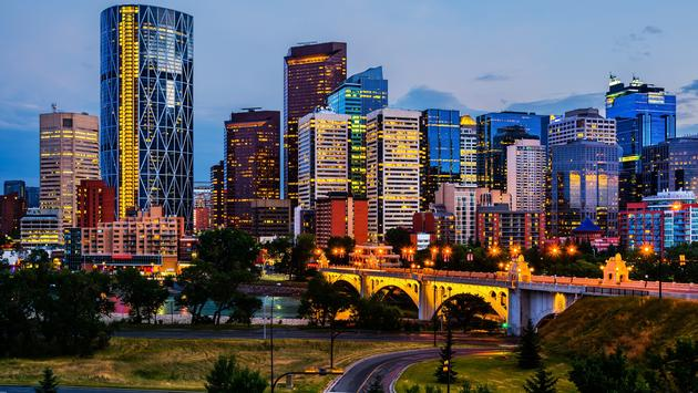 Buildings in Calgary Canada at night (Photo via  photoquest7 / iStock / Getty Images Plus)
