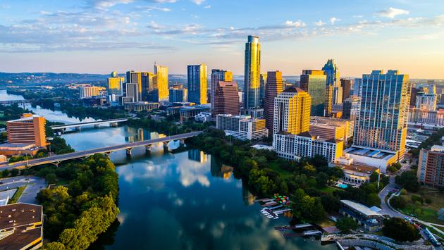 The Austin Texas Sunrise of 2017 The Travel Destination Cityscape Skyline - Sunrise Cityscape Austin Texas at Golden Hour Above Tranquil Lady Bird Lake (photo via RoschetzkyIstockPhoto / iStock / Getty Images Plus)