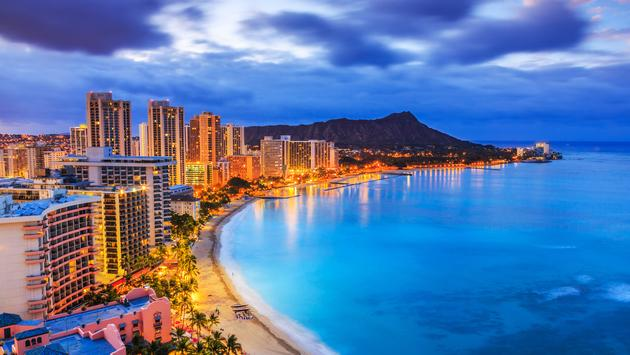 Honolulu, Hawaii. Skyline of Honolulu, Diamond Head volcano including the hotels and buildings on Waikiki Beach. (sorincolac / iStock / Getty Images Plus)