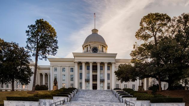 Alabama's State Capital Building (photo via Redheadedhornet/iStock/Getty Images Plus)