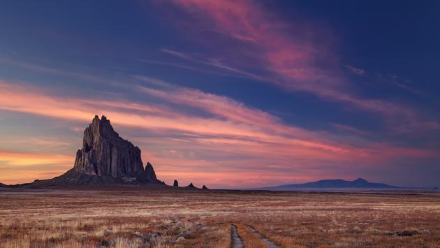 Shiprock, the great volcanic rock mountain in desert plane of New Mexico, USA (muha04 / iStock / Getty Images Plus)