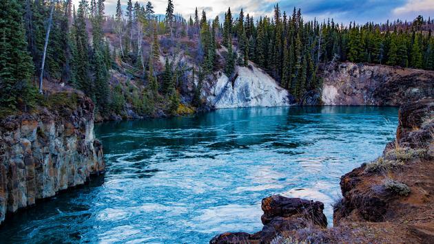 The Yukon river running through Miles Canyon. (photo via HeatherECampbell / iStock / Getty Images Plus)