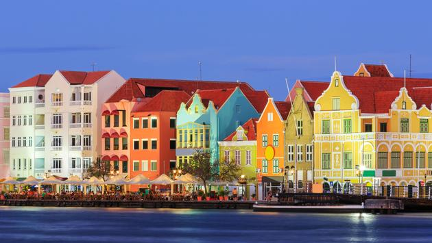 View of downtown Willemstad at twilight. Curacao, Netherlands Antilles (Photo via sorincolac / iStock / Getty Images Plus)