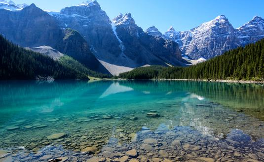 The Moraine Lake in Banff National Park, Alberta, Canada on a mid-summer morning (photo via Vinay_Bavdekar/iStock/Getty Image Plus)