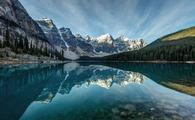 Moraine Lake reflection on a calm morning in Banff National Park, Alberta, in the heart of the Canadian Rockies. (photo via P_L_photography/iStock/Getty Images Plus)