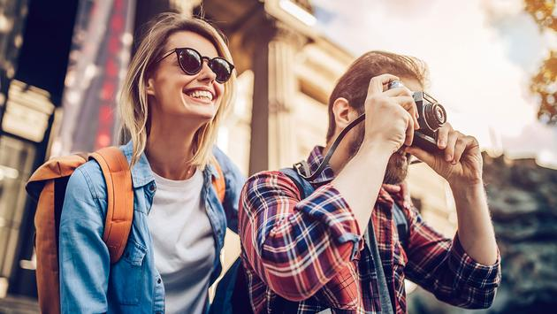 Couple of tourists (Vasyl Dolmatov / iStock / Getty Images Plus)