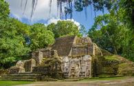 Lamanai Ruins in Belize (Photo via SimonDannhauer / iStock / Getty Images Plus)