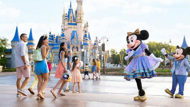 Minnie and Mickey greet park guests at Walt Disney World.