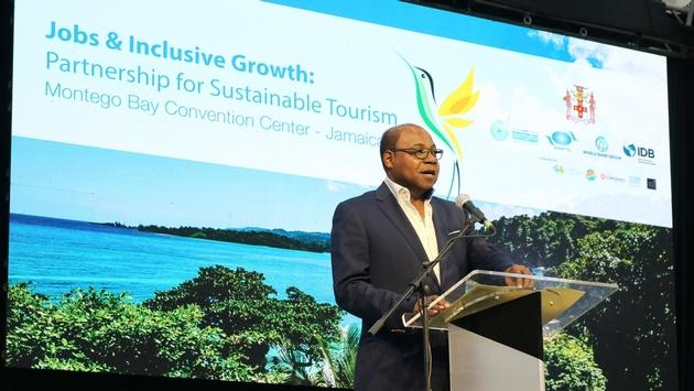 The Hon. Edmund Bartlett, minister of tourism for Jamaica, addresses delegates at the UNWTO's Global Conference on Jobs and Inclusive Growth: Partnerships for Sustainable Tourism.