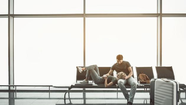 Couple relaxing at the airport before flight