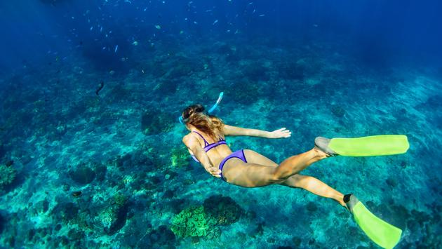 A woman snorkeling in the Bahamas