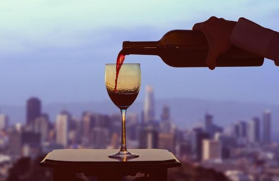 A glass of wine with San Francisco in the background