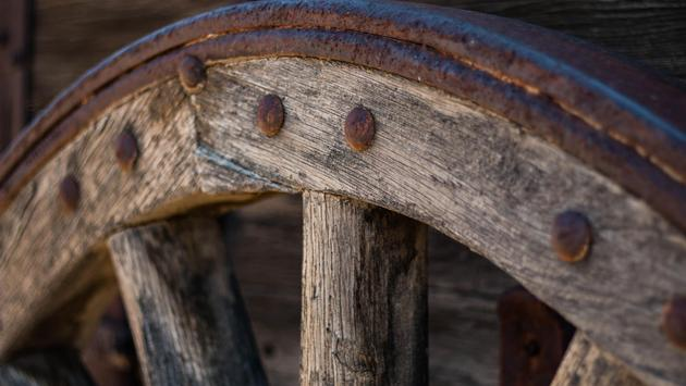 An old wooden wagon wheel