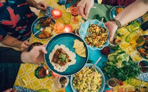 Friends sharing a Mexican meal