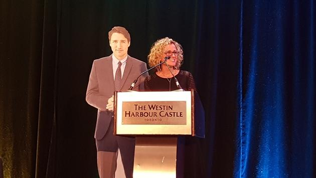 Johanne Bélanger, president and CEO of Tourism Toronto, with a little support from a friend, addressed the IGLTA audience.