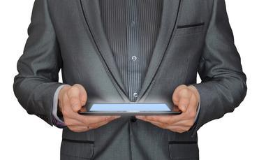 Businessman holding computer tablet