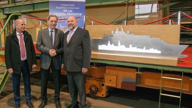Tom Wolber, Crystal President and CEO, MV WERFTEN CEO Jarmo Laakso and Mecklenburg-Western Pomerania's Economics Minister Harry Glawe (left to right) at MVW Crystal Endeavor's first steel cut