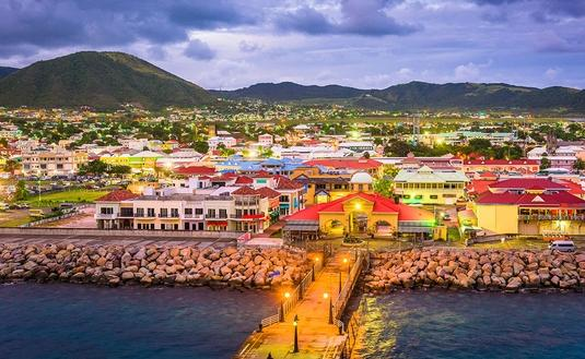 Basseterre, St. Kitts and Nevis town skyline at the port. (Photo via Sean Pavone / iStock / Getty Images Plus)