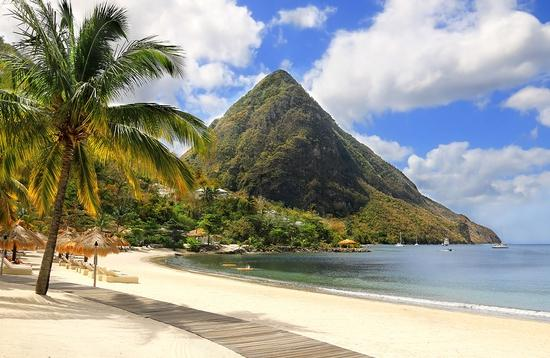 Beautiful white sand beach in Saint Lucia, Caribbean Islands (Photo via IngaL / iStock / Getty Images Plus)