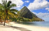 Beautiful white sand beach in Saint Lucia, Caribbean Islands (Photo via IngaL / iStock / Getty Images Plus)