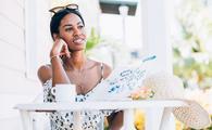 Young Black woman enjoying time at a summer resort.