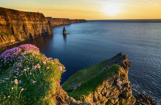 Sunset over the Cliffs of Moher in County Clare along Ireland's Wild Atlantic Way.