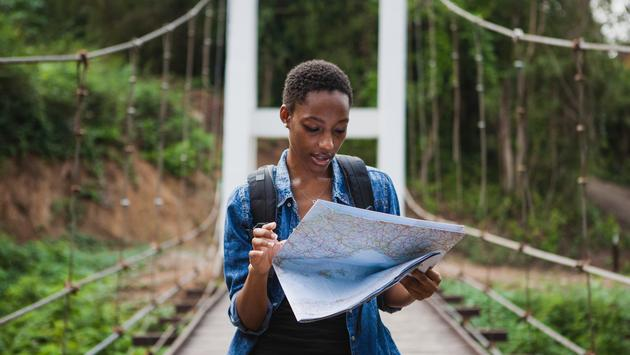 African American traveler looking at a map