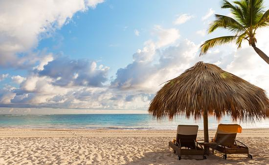 sand beach in Punta Cana, Dominican Republic (Photo via Preto_perola / iStock / Getty Images Plus)