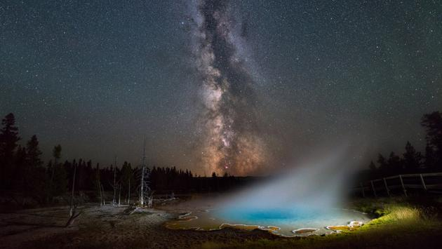 The Milky Way drifts by Silex Spring in Yellowstone National Park.