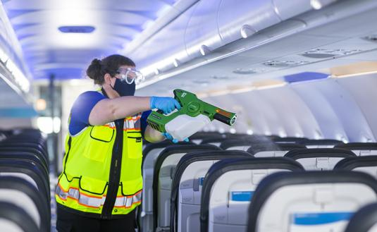 Plane cabins are sanitized using electrostatic disinfectant sprayers.