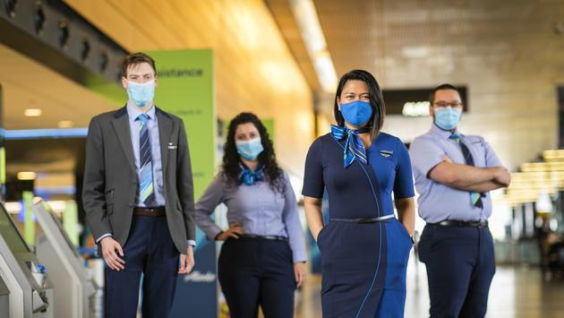 Face masks are required to be worn by all airline staff.