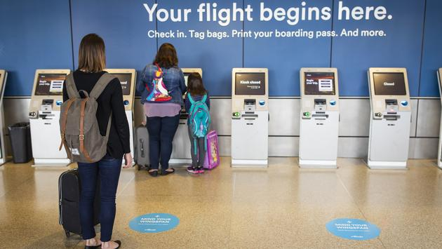 Social-distancing floor decals at Alaska Airlines check-in.