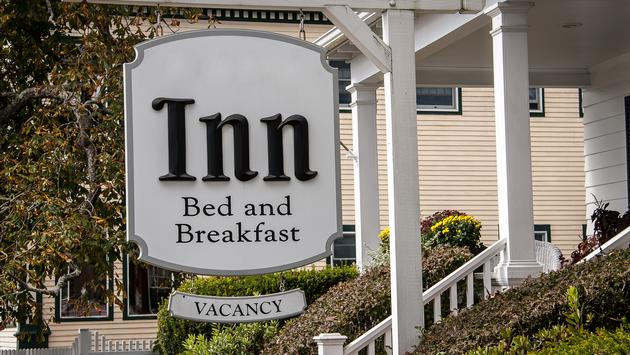 White sign for a bed and breakfast with vacancy