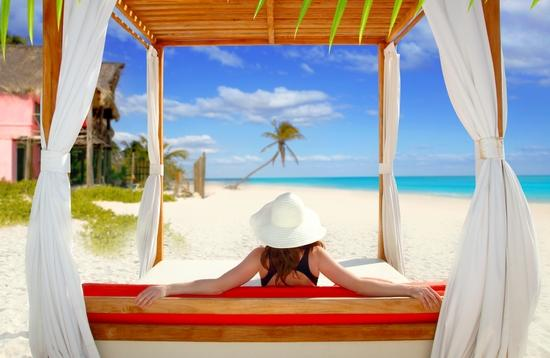 A woman relaxes on the beach in Tulum, Mexico