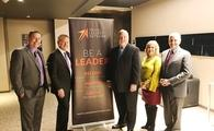 Roger Block, president of Travel Leaders Network (third to the right) and top company personnel are ready for 2018